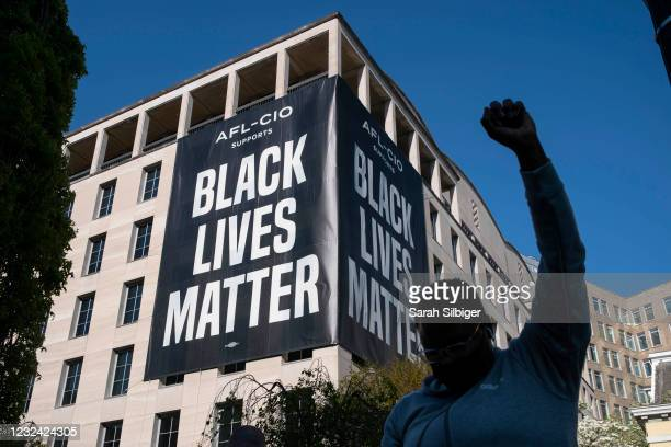 Person celebrates the verdict of the Derek Chauvin trial at Black Lives Matter Plaza near the White House on April 20, 2021 in Washington, D.C....