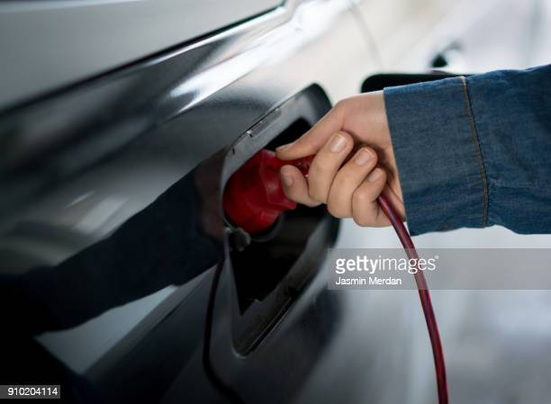 Person charging new technology electric car