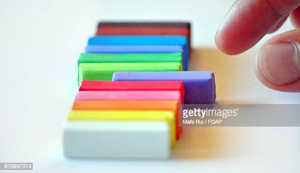A person choosing purple chalk