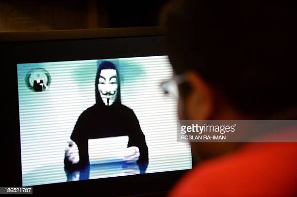A person claiming to speak for activist hacker group Anonymous is seen issuing a warning throught a video circulated online to 'go to war' with the...