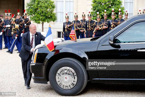A person cleans the car of US President Donald Trump at the Elysee Presidential Palace on July 13 2017 in Paris France As part of the commemoration...