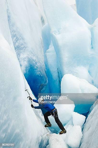 Person climbing on frozen mountainside, Santa Cruz Province, Argentina