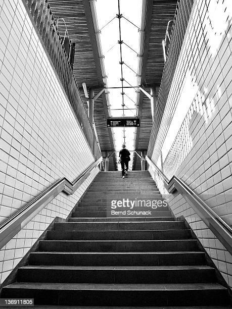person climbing stairs - bernd schunack stockfoto's en -beelden