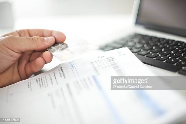 Person conducting online banking with credit card