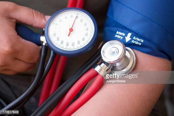 A person controlling and taking their blood pressure