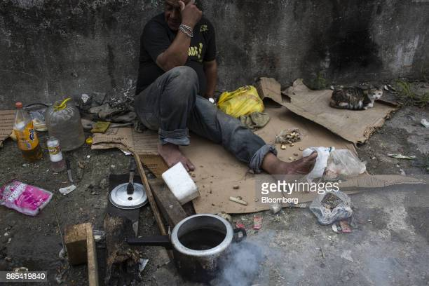 A person cooks beans on the side of a road in cooks beans on the side of a road in Duque de Caxias Rio de Janeiro State Brazil on Thursday Aug 24...