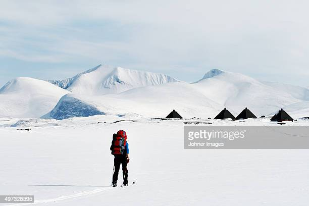 Person cross country skiing, Abisko, Lapland, Sweden