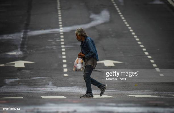 Person cross the Cordoba avenue on March 31, 2020 in Buenos Aires, Argentina. Last Sunday President Fernandez announced an extension of the total...