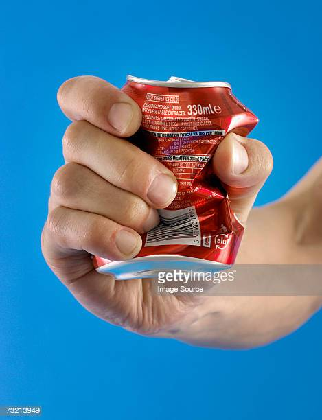 Person crushing a can in their hand