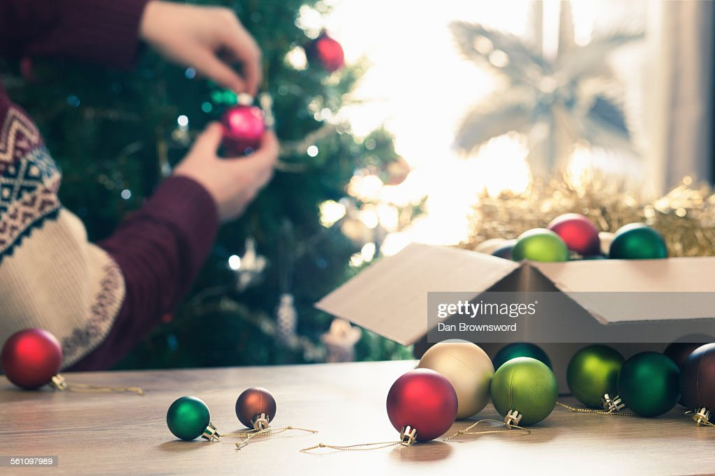 Person decorating christmas tree : Stock Photo