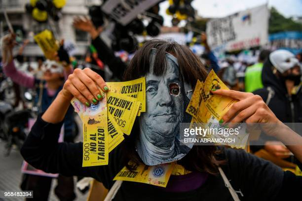 A person demonstrates against the rise of public services fares and the government's negotiations with the International Monetary Fund in Buenos...