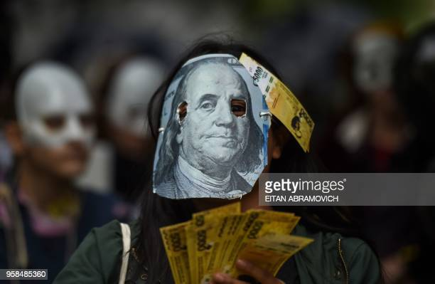 TOPSHOT A person demonstrates against the rise of public services fares and the government's negotiations with the International Monetary Fund in...