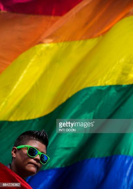 """Person demonstrates on International Day Against Homophobia, Transphobia and Biphobia """"for a Nicaragua without discrimination"""" to focus on..."""