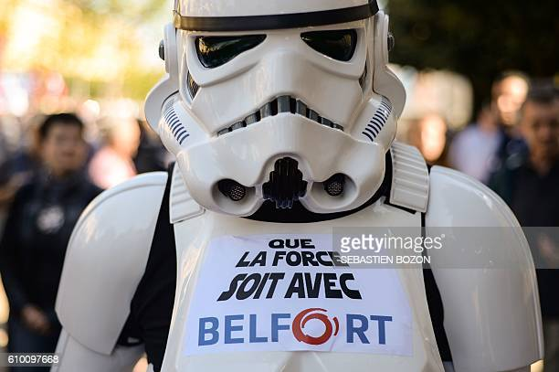 A person demonstrates wearing a stormtrooper costume with a sticker reading 'May the Force be with Belfort' during a during a demonstration against...