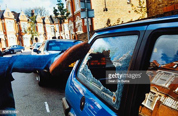 person destroying car window, clapham, london, england - crime stock pictures, royalty-free photos & images