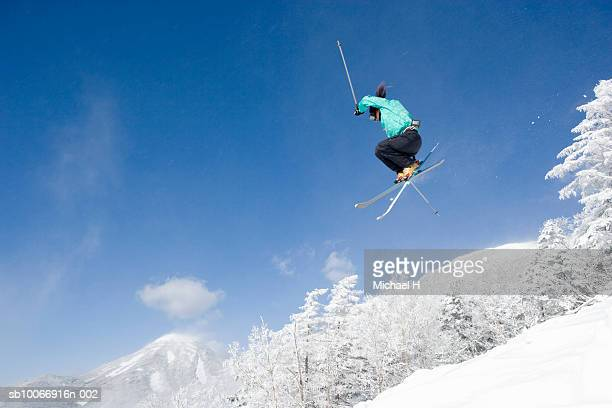 Person doing jump on skis