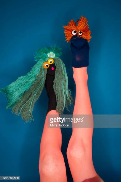 person doing sock puppet show with feet - leg show stock pictures, royalty-free photos & images