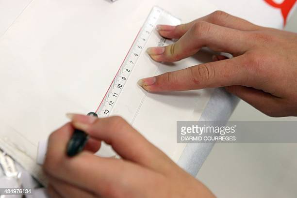 A person draws a lign with a ruler for lefthanded users in the Salle du Pont du Buy in Brivela Gaillarde where writing and cooking workshops were...