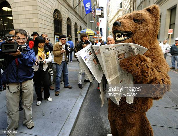 A person dressed as a bear to represent a bear market performs outside the New York Stock Exchange on October 6 200 in New York Wall Street tumbled...