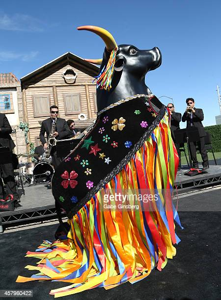 A person dressed as a bull performs in front of the Spock Frevo Orchestra at a news conference for the unveiling of the Rock in Rio USA music...
