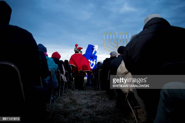 A person dressed as a dreidel dances during the National Chanukah Menorah lighting on the Ellipse December 12 2017 in Washington DC