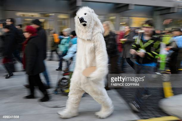 A person dressed as a polar bear walks in Geneva on November 28 2015 during a rally ahead of the UN climate summit COP21 Protesters joined a...
