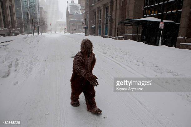 A person dressed as bigfoot makes their way through the strong wind and snow in the Back Bay neighborhood during a blizzard on January 27 2015 in...