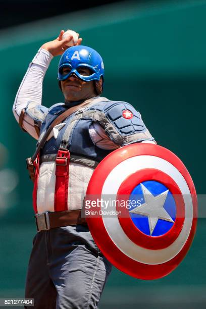 A person dressed as Captain America throws out the first pitch before the game between the Chicago White Sox and the Kansas City Royals at Kauffman...
