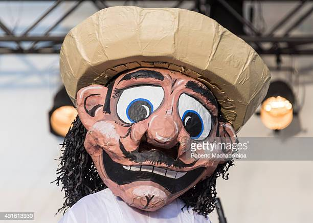 SQUARE TORONTO ONTARIO CANADA Person dressed as cartoon character standing on stage entertaining the crowd at MexFest 2015 in Toronto MexFest 2015 is...