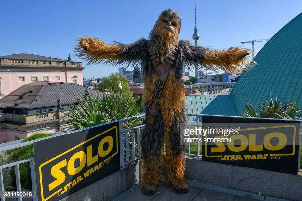 A person dressed as Chewbacca of Star Wars poses during a promotional event to present the film «Solo A Star Wars Story» by US director Ron Howard on...
