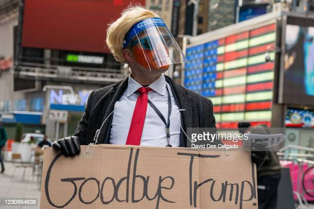 Person dressed as Donald Trump at Times Square to watch Joe Biden sworn in as 46th President Of The United States at the U.S. Capitol Inauguration...