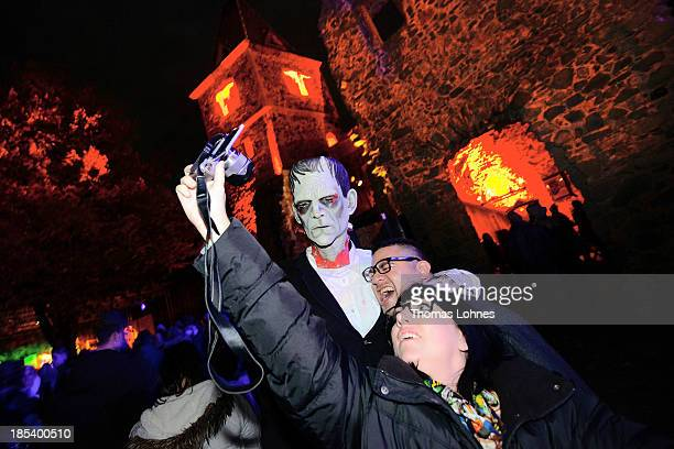 A person dressed as Frankenstein's monster poses for visitors at Frankenstein castle on October 19 2013 in Darmstadt Germany Grotesque monsters...