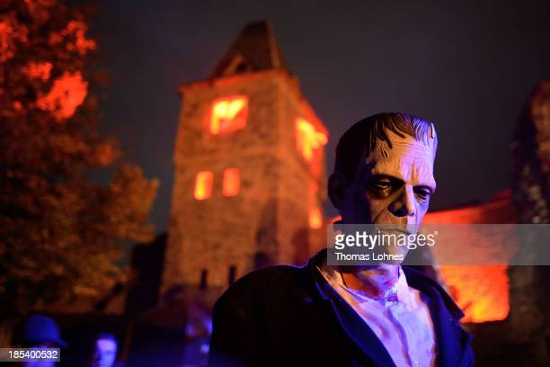 A person dressed as Frankenstein's monster tries to scare visitors at Frankenstein castle on October 19 2013 in Darmstadt Germany Grotesque monsters...