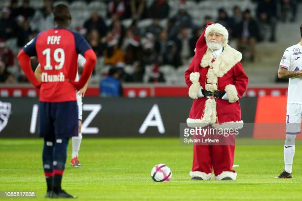 A person dressed as Santa Claus for the start of the Ligue 1 match between Lille and Toulouse at Stade Pierre Mauroy on December 22 2018 in Lille...