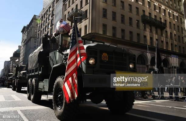 A person dressed as Santa Claus is driven along the Veterans Day Parade route on a convoy commander on November 11 2017 in New York City The largest...