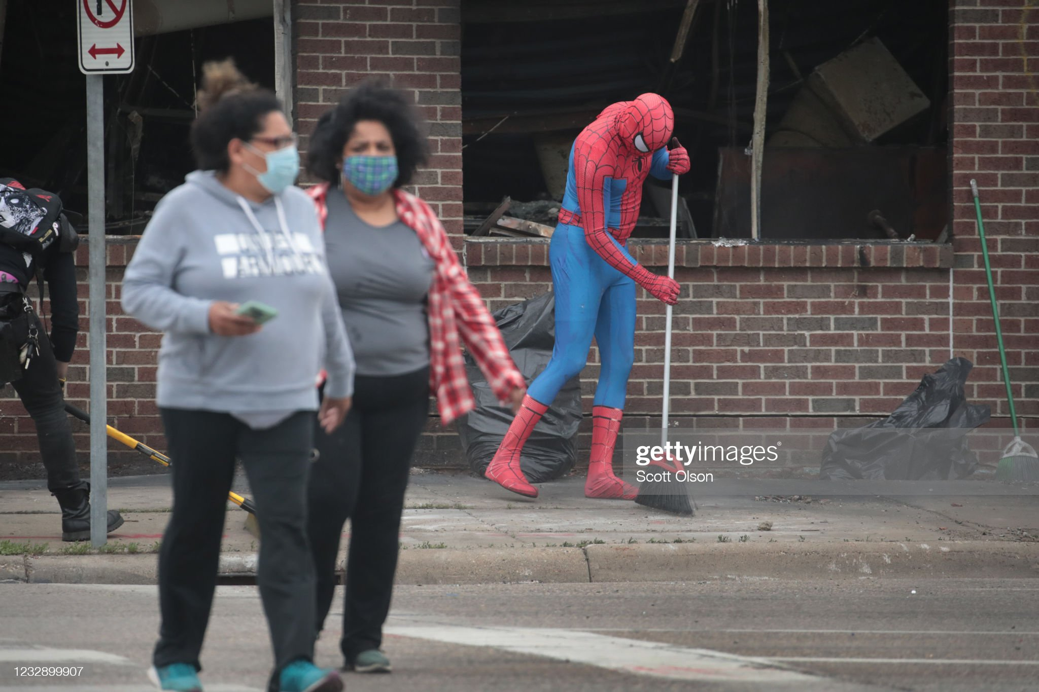 person-dressed-as-spiderman-sweeps-the-s