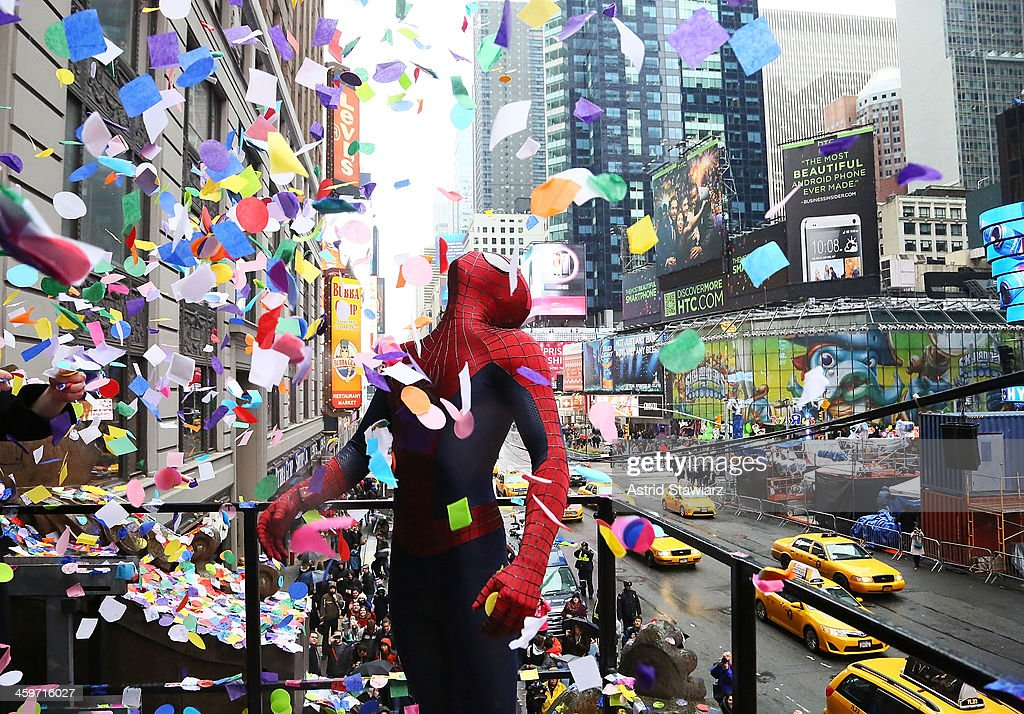 A person dressed as Spider-Man throws confetti during the 2014 New Year's Eve Confetti Test at Hard Rock Cafe, Times Square on December 29, 2013 in New York City.