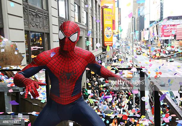 A person dressed as SpiderMan throws confetti during the 2014 New Year's Eve Confetti Test at Hard Rock Cafe Times Square on December 29 2013 in New...