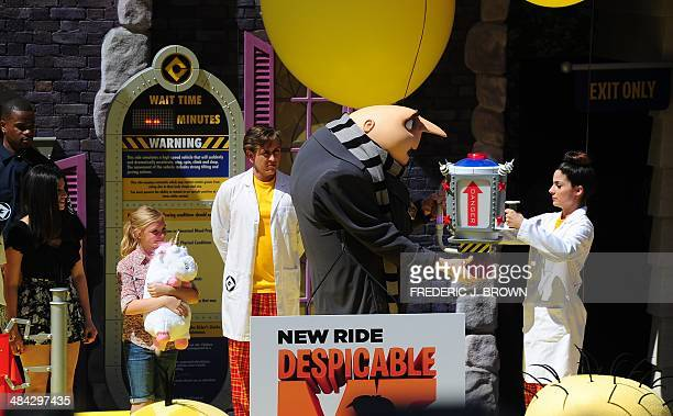 A person dressed as the character 'Gru' is handed 'the detonator' at a ceremony marking the opening of Universal Studio's latest attraction...
