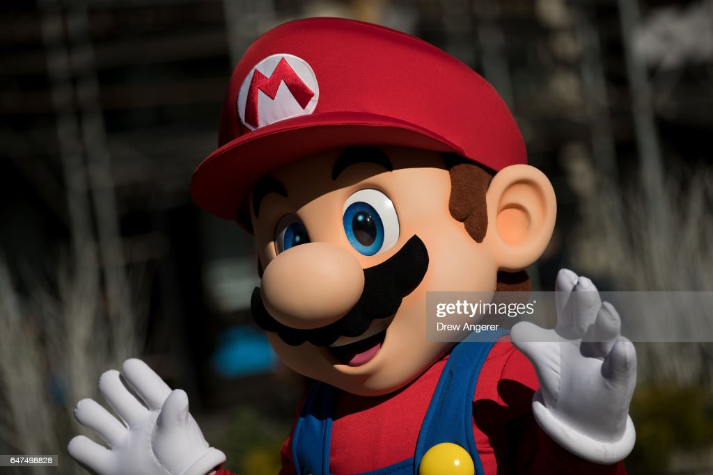 A person dressed as the Nintendo character Mario waves at a pop-up Nintendo venue in Madison Square Park, March 3, 2017 in New York City. The Nintendo Switch console goes on sale today and retails for 300 dollars.
