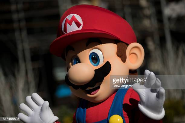 A person dressed as the Nintendo character Mario waves at a popup Nintendo venue in Madison Square Park March 3 2017 in New York City The Nintendo...