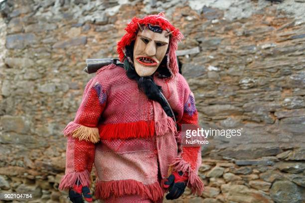 A person dressed for a masquerade wearing an ancient mask takes part in a winter masquerade gathering in Salsas Portugal on Saturday January 6 2018...