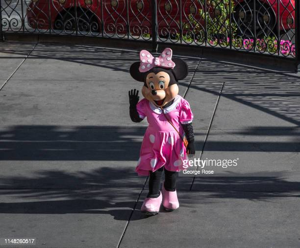 A person dressed in a Minnie Mouse costume hoping to pose with tourists for tips stands outside the Flamingo Hotel Casino on May 6 2019 in Las Vegas...