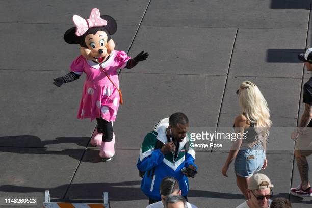 Person dressed in a Minnie Mouse costume, hoping to pose with tourists for tips, stands outside the Flamingo Hotel & Casino on May 6, 2019 in Las...