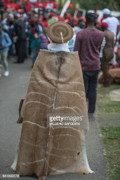 A person dressed in a traditional outfit arrives at the house of late South African antiapartheid campaigner Winnie MadikizelaMandela exwife of...