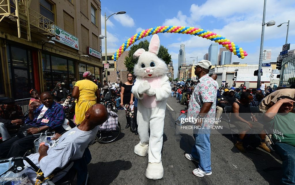 A person dressed in an easter bunny costume arrives to greet the a person dressed in an easter bunny costume arrives to greet the homeless on skid row awaiting their annual good friday meal hosted by the la mission and m4hsunfo