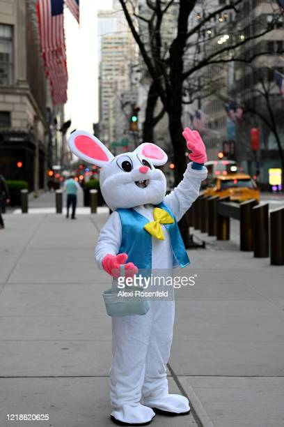 A person dressed in bunny costume waves to passerby's on Easter Sunday along Fifth Avenue amid the coronavirus pandemic on April 12 2020 in New York...