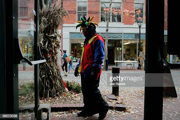 A person dressed in Halloween costume walks though streets as he visits the town where back in 1692 witch trials took place October 27 2005 in Salem...