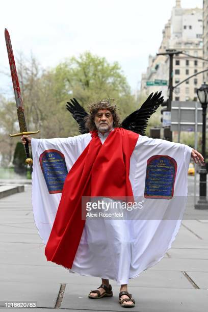 A person dressed up as Jesus walks near Central Park on Easter Sunday amid the coronavirus pandemic on April 12 2020 in New York City United States...