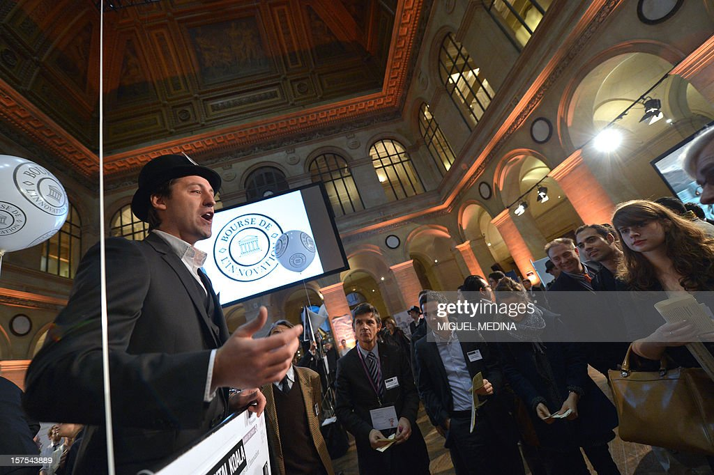A person dressesed in historic garb speaks at the Palais Brongniard in Paris on December 4, 2012 during the launch of the first 'Innovation stock market' where 40 start-ups were symbolically quoted on the exchange. AFP PHOTO / Miguel MEDINA